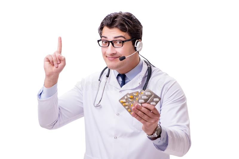The young doctor with phone headset isolated on white. Young doctor with phone headset isolated on white royalty free stock image