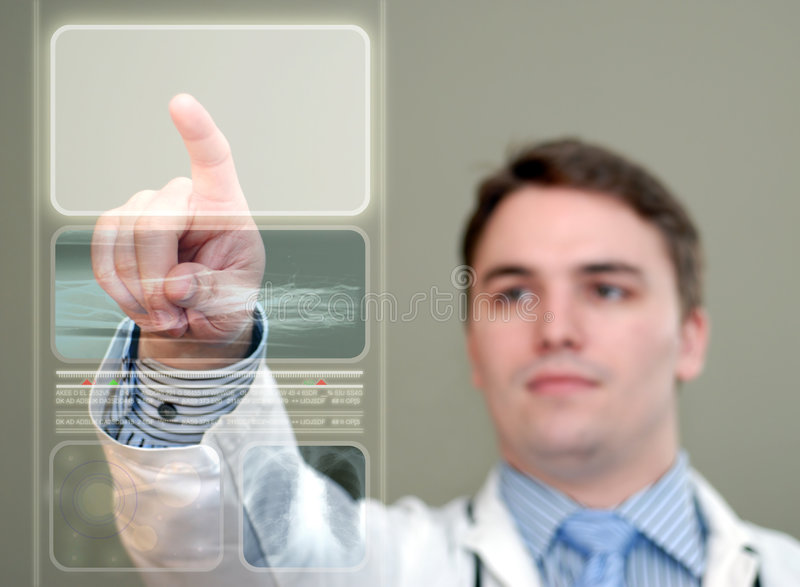 Young Doctor Pressing Glowing Button on Translucent Medical Display. Young doctor pushing a glowing area on a translucent, futuristic medical display stock images