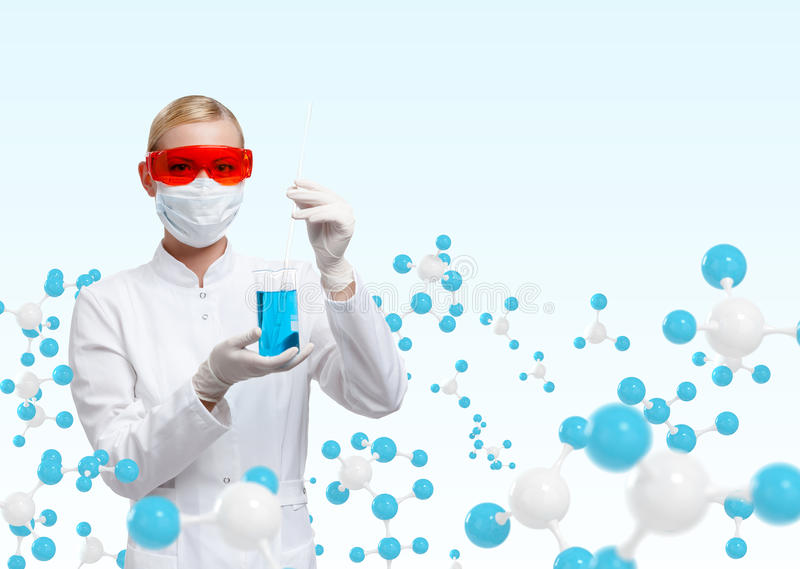 Young doctor in respirator holds a glass beaker on molecular compound background. Medical research concept royalty free stock images