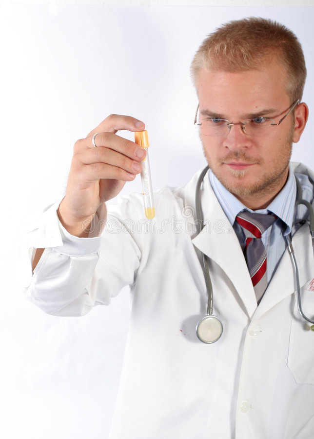 Young doctor see a test-tube. A young immunologist doctor check a test-tube stock image