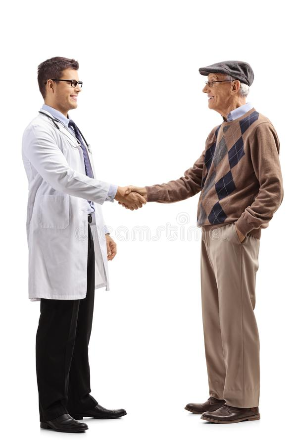 Young doctor shaking hands with an elderly man stock images