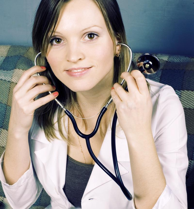 Young doctor with stethoscope medical inspection at home, person. Al healthcare, lifestyle people concept stock image