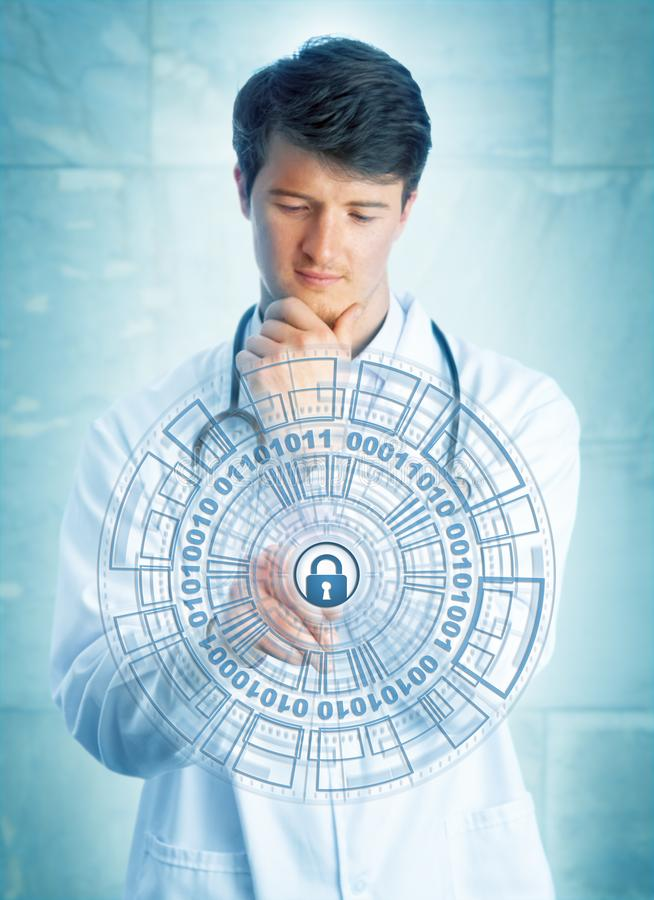 Young Doctor Touching Cybersecurity Mechanism. Young pensive medical doctor touching a virtual padlock in a virtual security mechanism. Information technology stock photography
