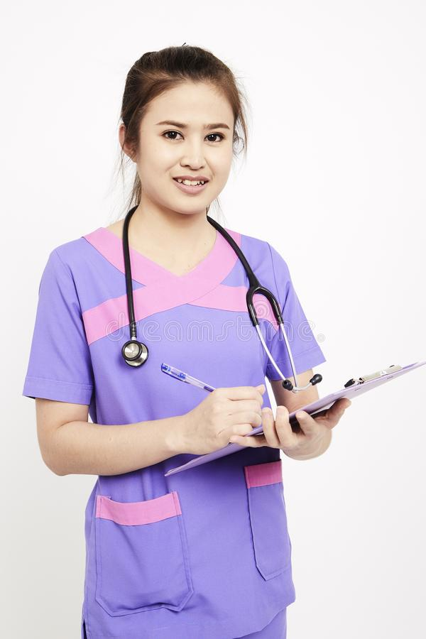 Female pediatrician at her office stock image