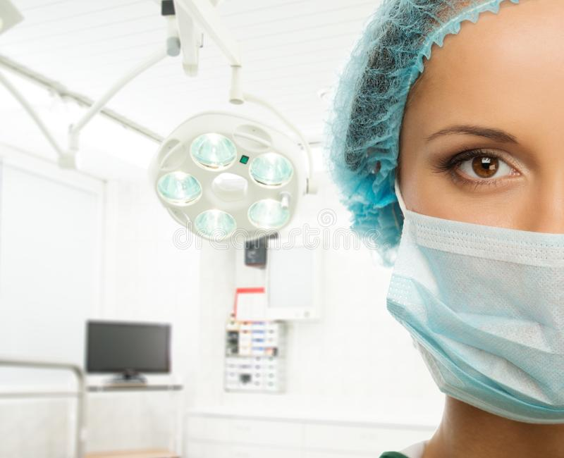 Young doctor woman in surgery room stock photo