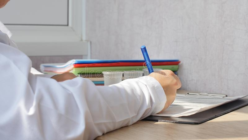 Young doctor is writting a prescription. stock images