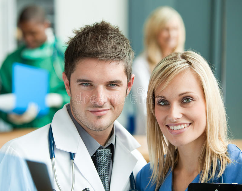 Young doctors in hospital. Reception stock photos