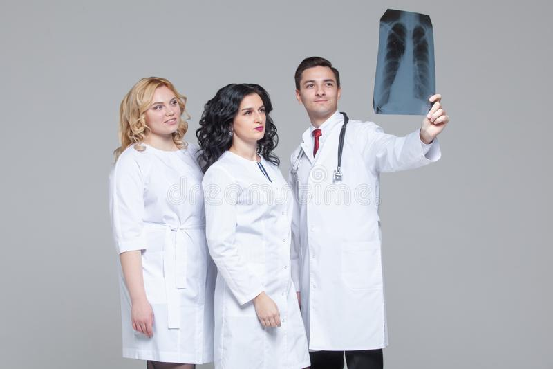 Young doctors looking at the x-ray picture of lungs.  stock photography