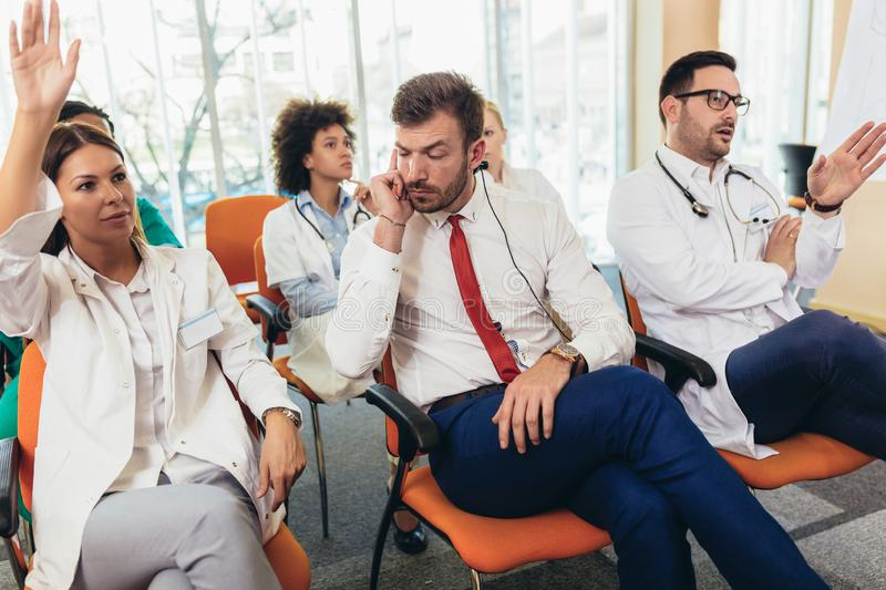 Young doctors on seminar in lecture hall at hospital stock images