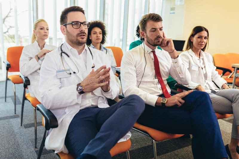 Young doctors on seminar in lecture hall at hospital royalty free stock images