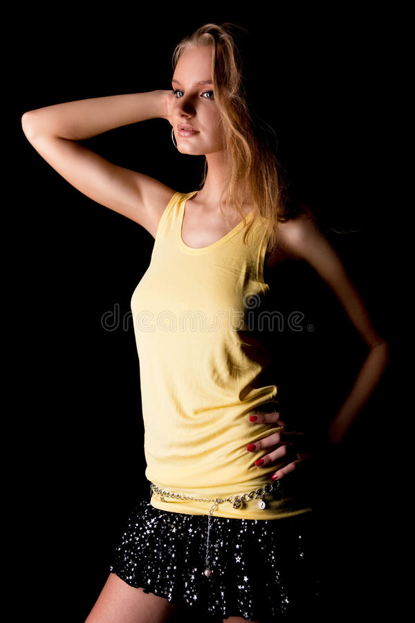 Young dreaming blonde with lifted hand standing royalty free stock images