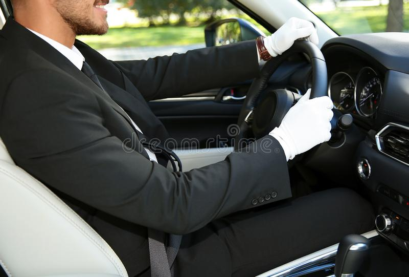 Young driver in luxury car. Chauffeur service royalty free stock images