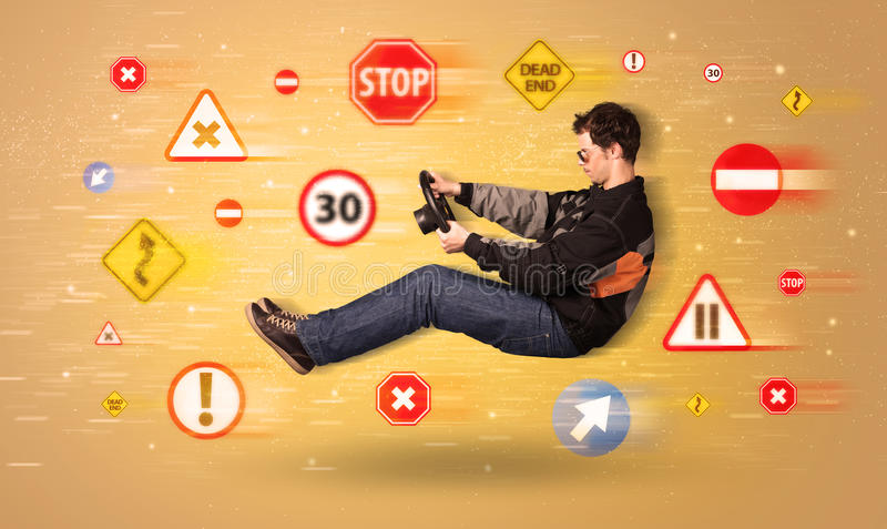 Young driver with road signs around him stock photography