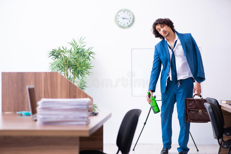 Young drunk employee in the office royalty free stock photos