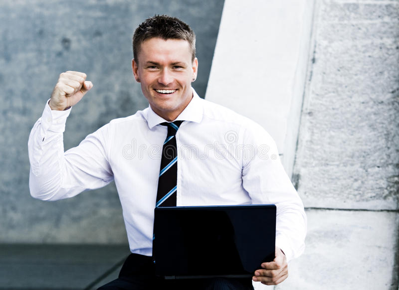 Download Young Elated Corporate Man With Laptop Stock Image - Image: 10338887