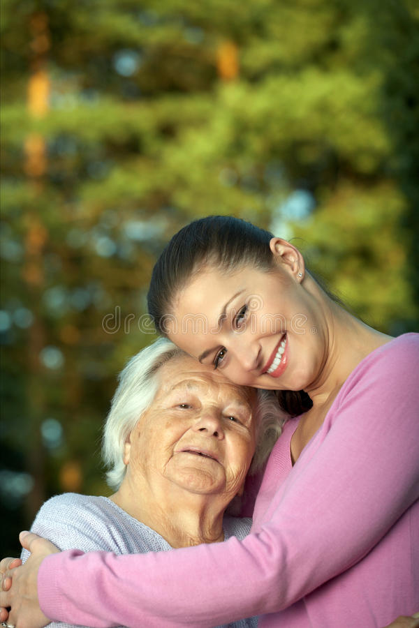 Young and elderly women stock image