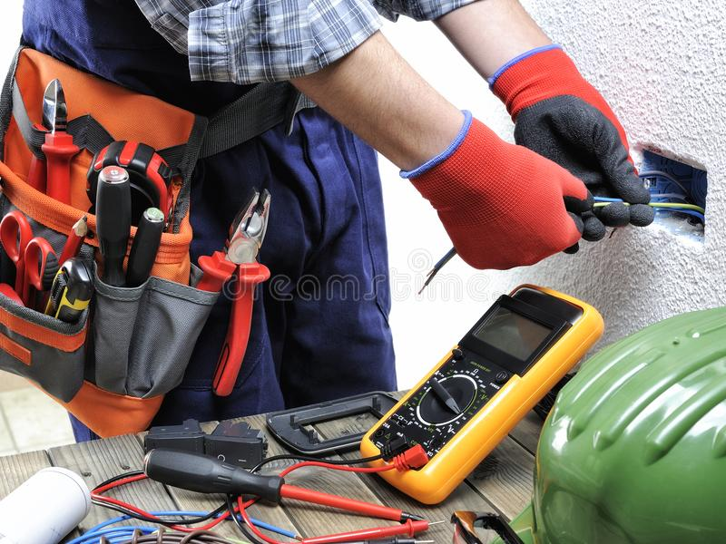 Young electrician technician works in compliance with safety sta stock photo