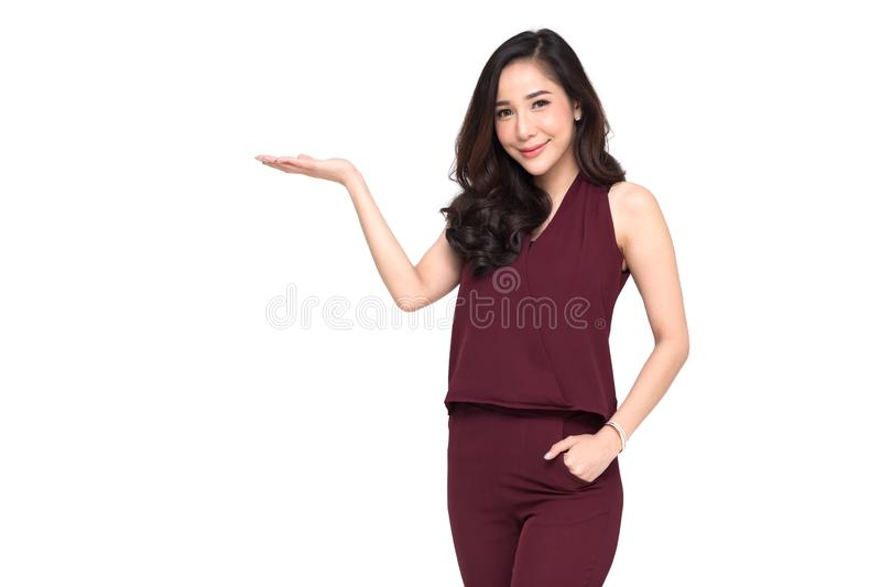 Young elegant Asian woman smiling and presenting royalty free stock image