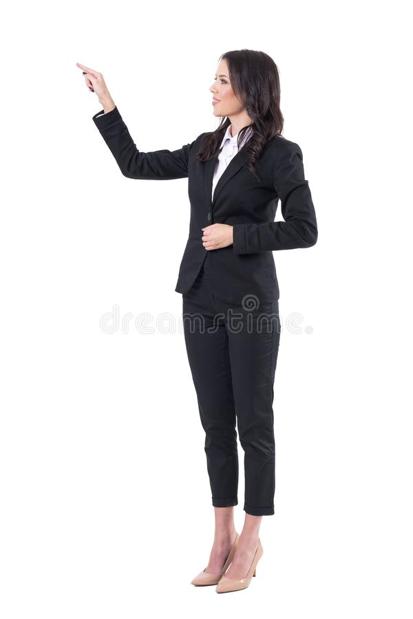 Young elegant business woman or teacher pointing finger and showing blank space stock image