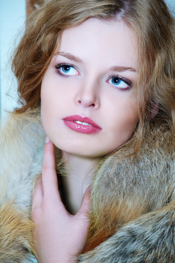 Young elegant girl with fur collar