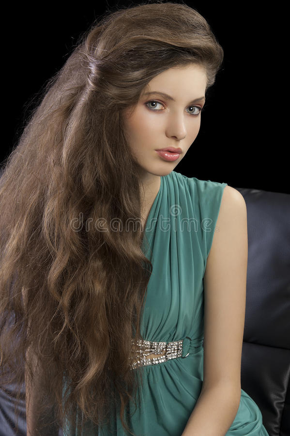 Young elegant girl in green stock photography