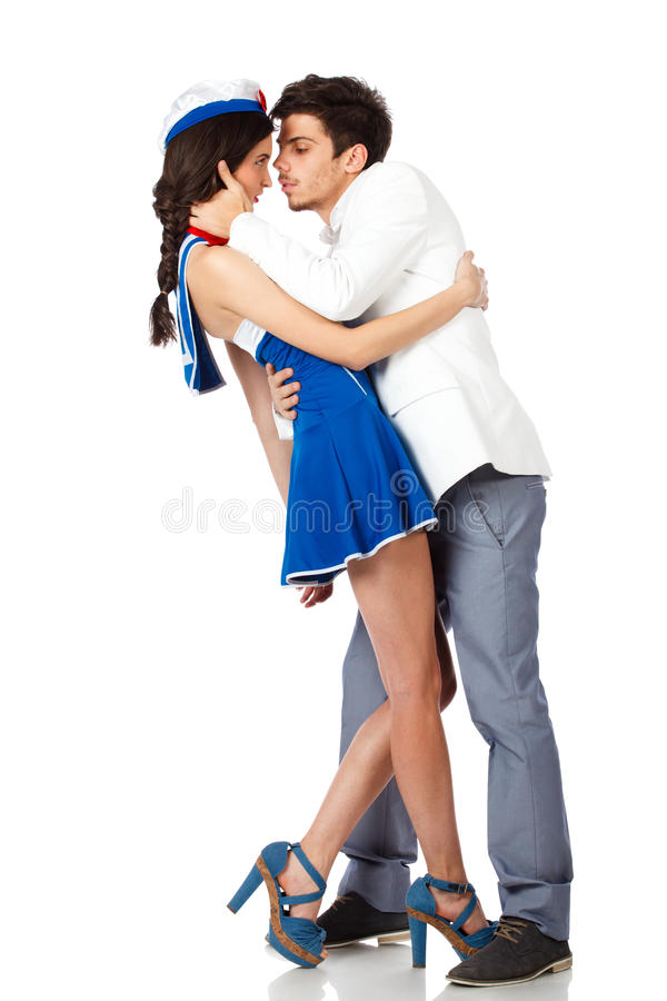 Young Elegant Man Kissing Sailor Woman Royalty Free Stock Photography