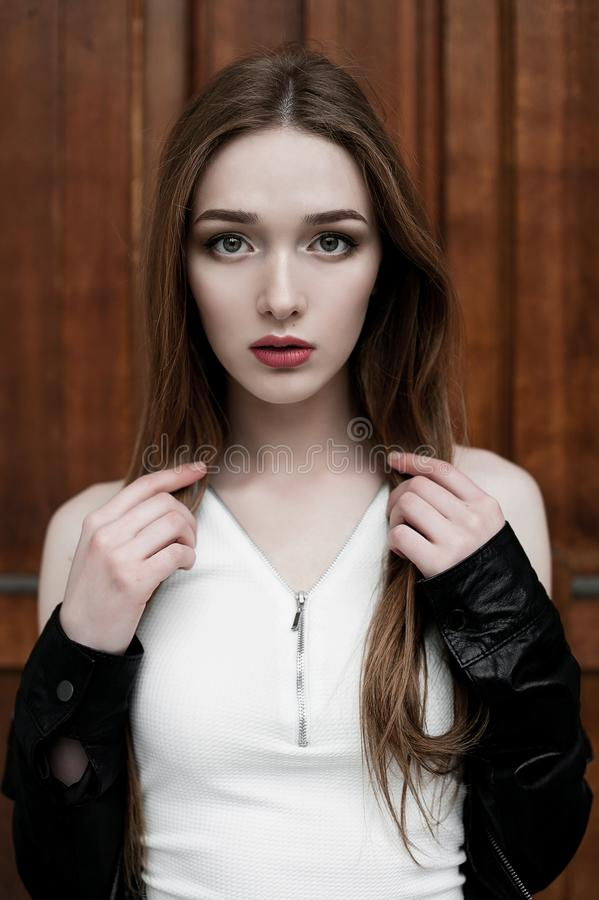 Young elegant trendy lady outdoors, wearing black and white clothing stock photography