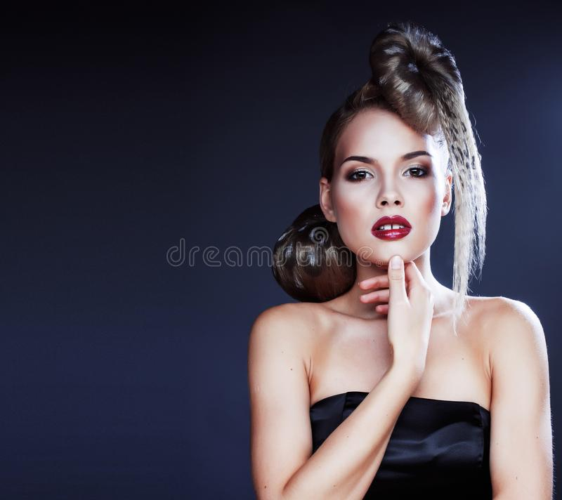 Young elegant woman with creative hair style leopard print. Close up royalty free stock photo