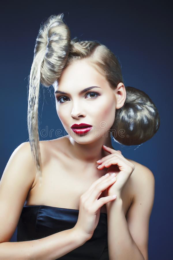 Young elegant woman with creative hair style leopard print close. Up on dark blue background, fashion model halloween selebration stock images