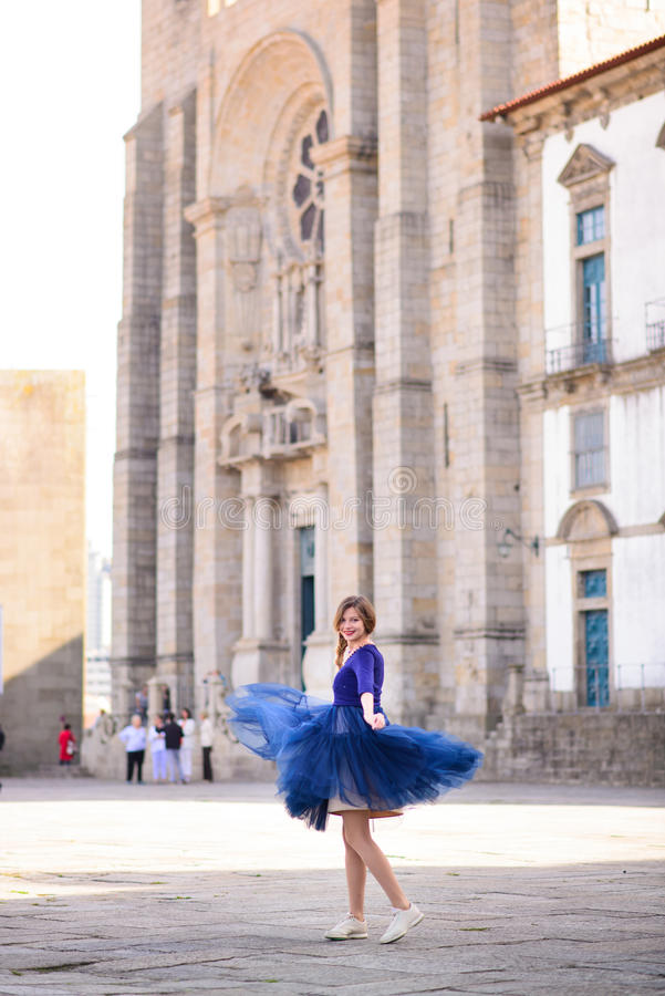 Free Young Elegant Woman In Blue Long Flying Dress Posing At Stairway Against Old City Building Stock Photo - 65082280