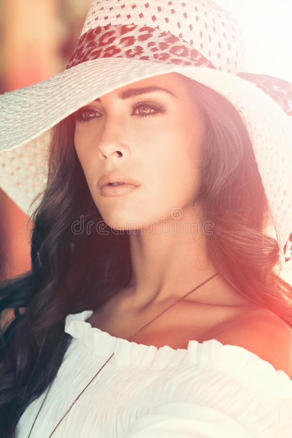 Young elegant woman outdoor portrait with hat summer day stock photo
