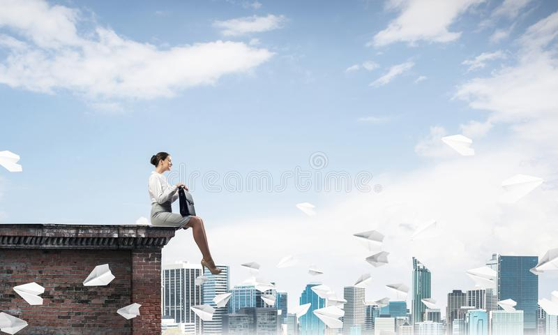 Businesswoman or accountant on building top and paper planes fly royalty free stock photos