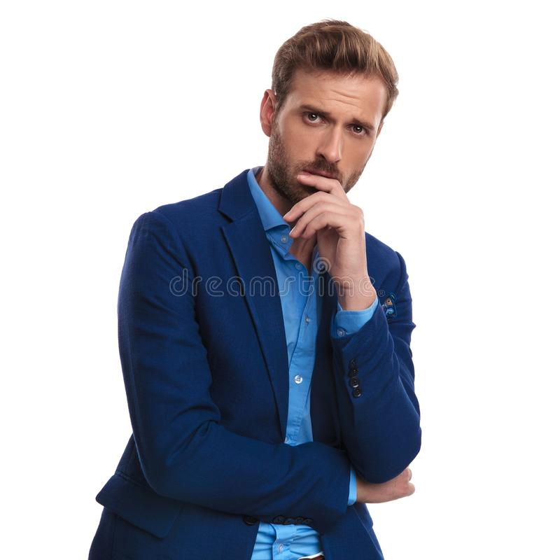 Young elegant worried man. Standing on white background stock photography
