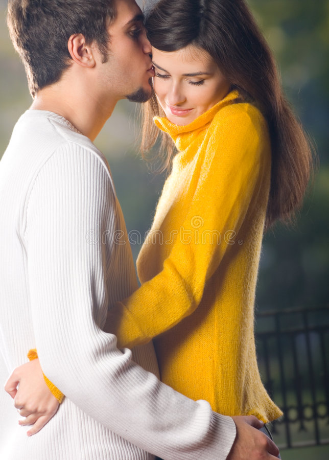 Young embracing couple royalty free stock photo