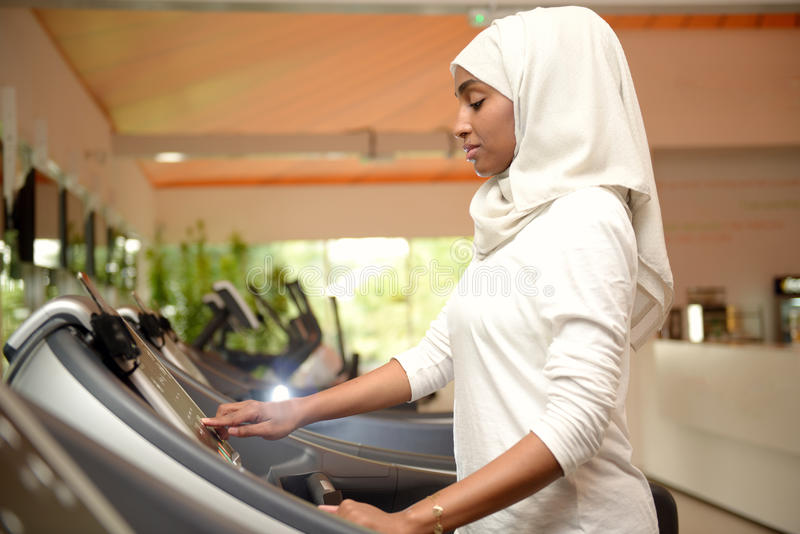 Young Emirati arab women wroking out in a Gym royalty free stock photography