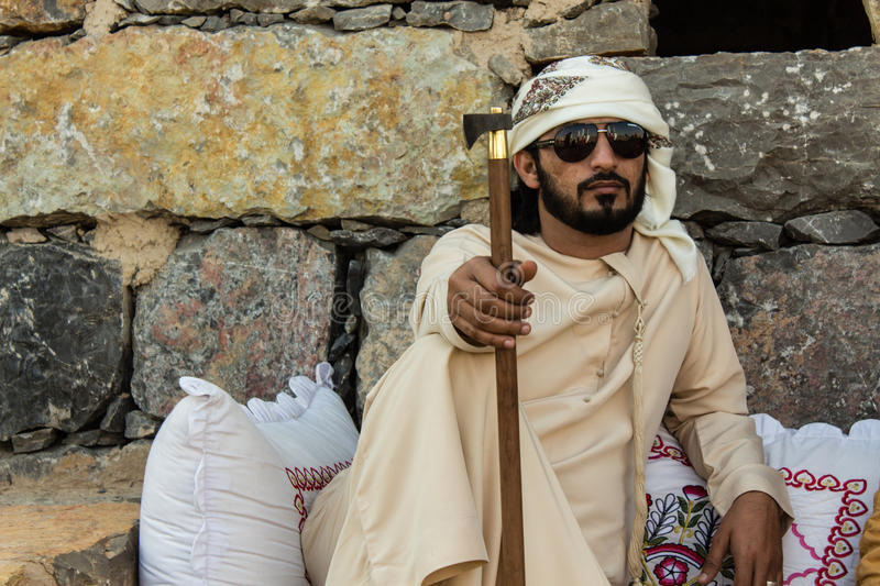 Young Emirati man sitting royalty free stock photography