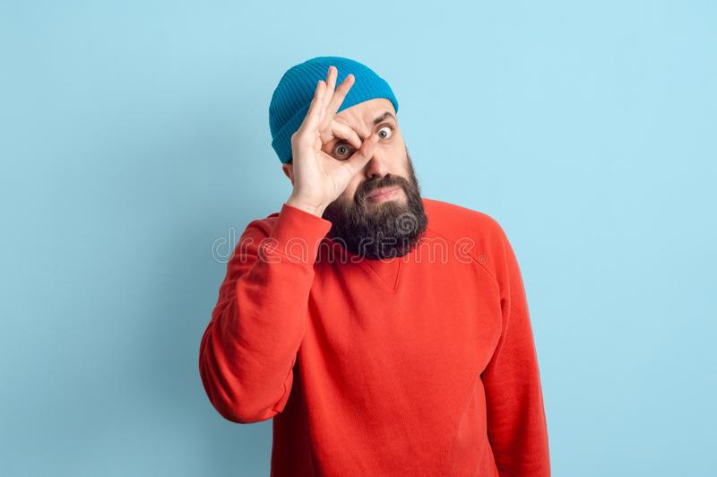 Young emotional bearded man and facial expression concept royalty free stock image