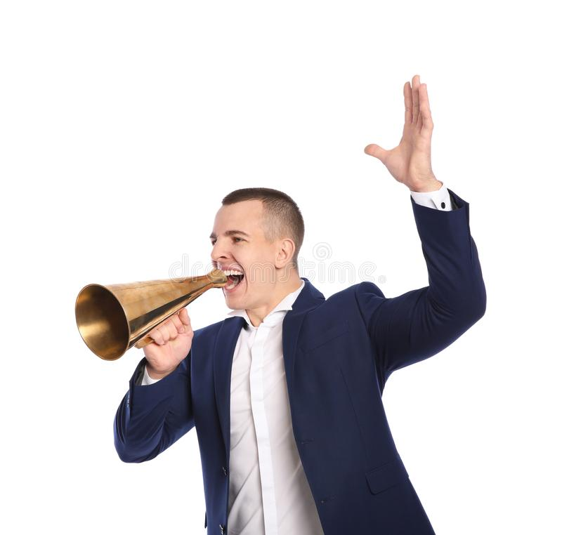 Young emotional businessman with megaphone on white. Background royalty free stock images