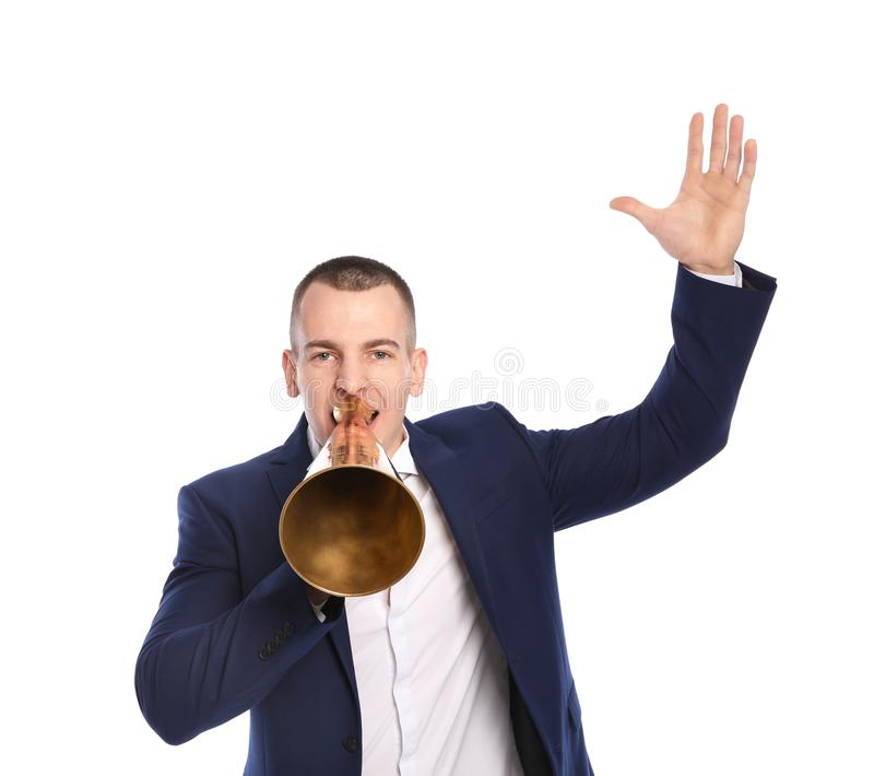 Young emotional businessman with megaphone on white. Background stock image