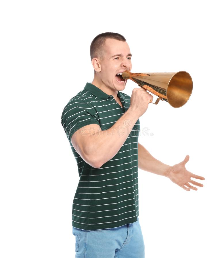 Young emotional man with megaphone on white. Background stock photo