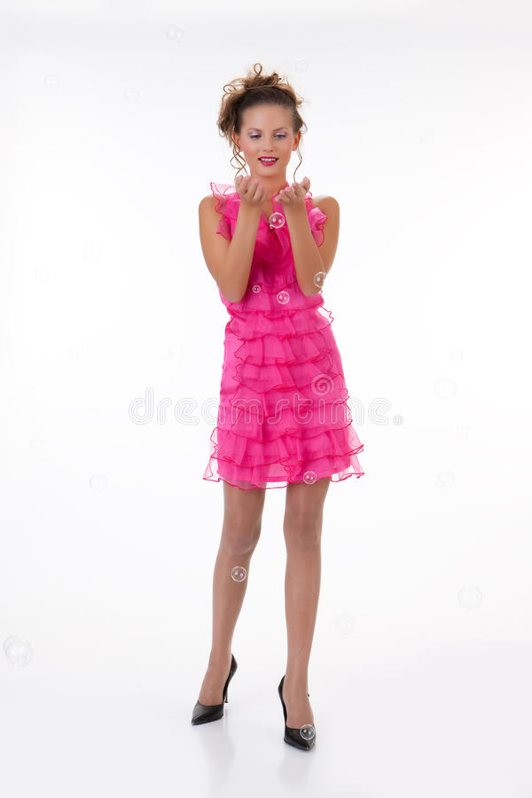 Download Young Emotional Woman In A Pink Dress Stock Image - Image of femininity, model: 11264411
