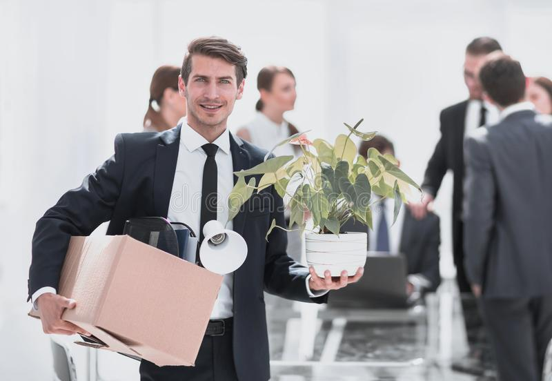 Young employee on the background of the new office stock image