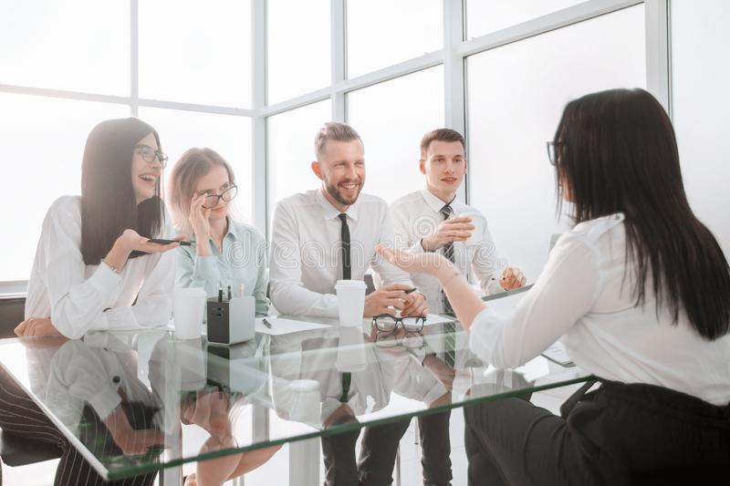Young employee of the company , answers questions during the interview. stock photo