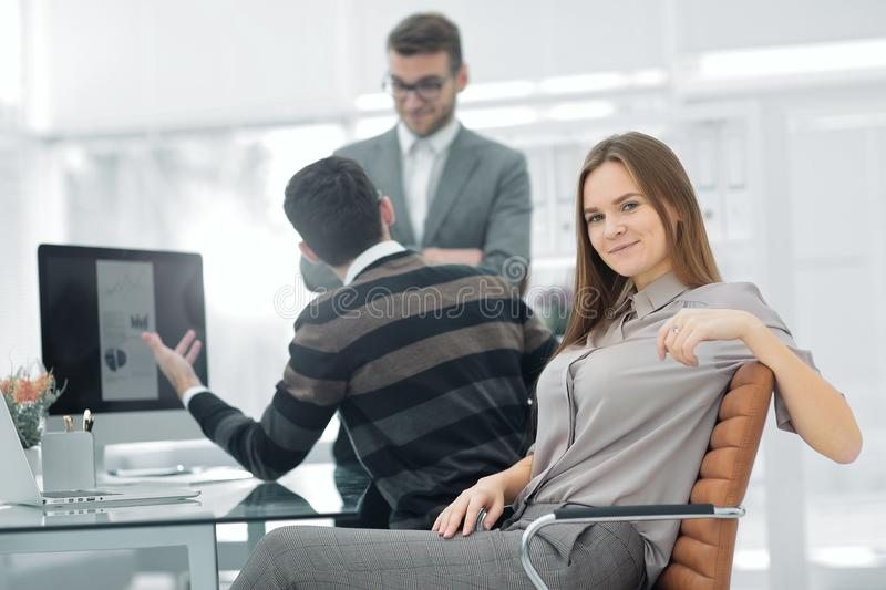 Young employee of the company on the background of business team royalty free stock image