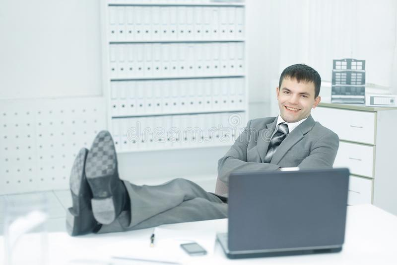 Young employee of a company resting on a workplace royalty free stock photos