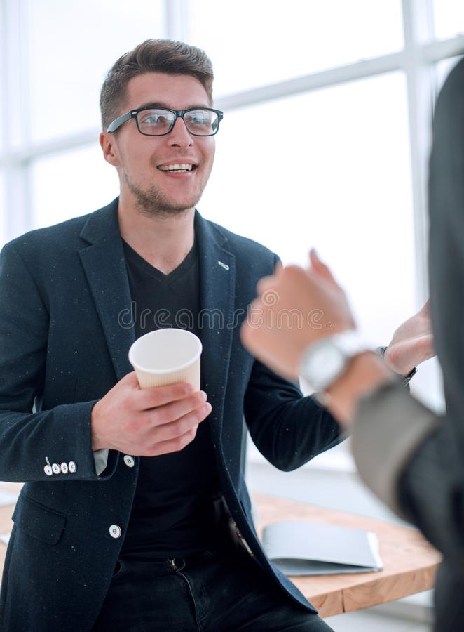 Young employee explaining to a colleague his ideas. royalty free stock photography