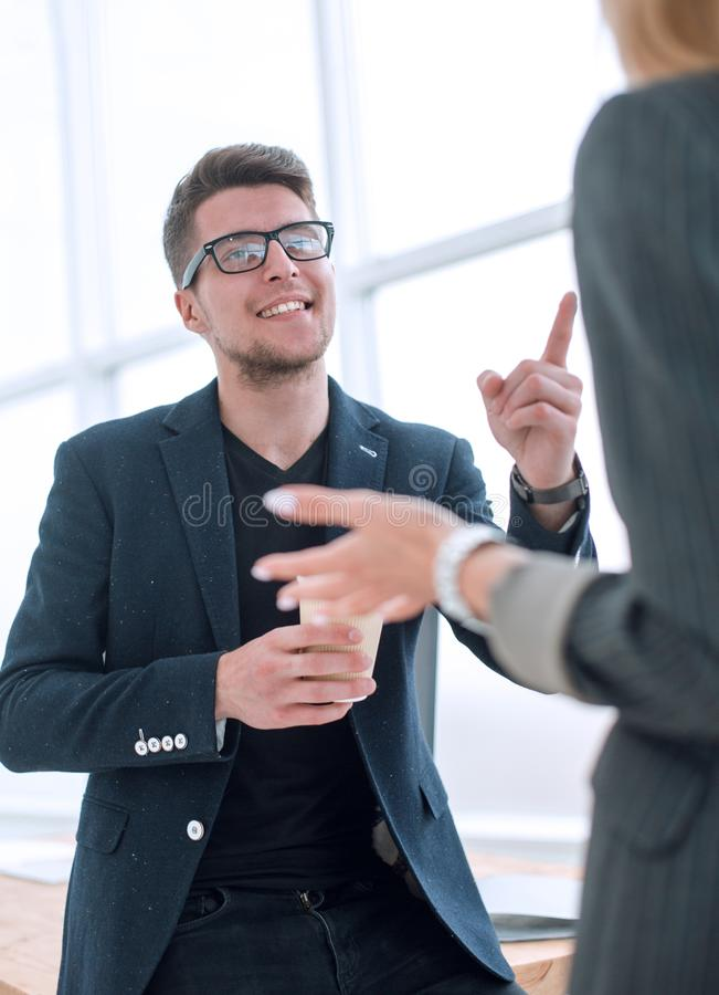 Young employee explaining to a colleague his ideas. stock photography