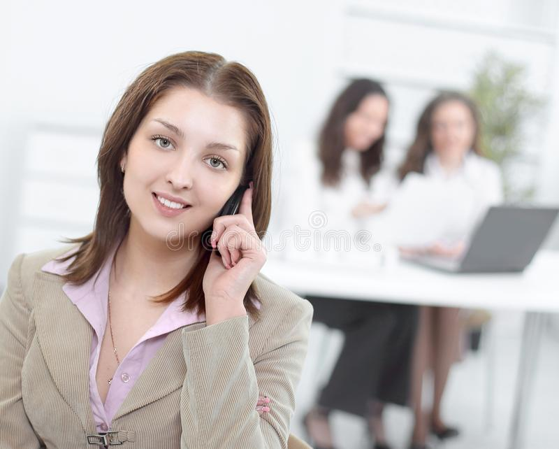 Young employee on the phone in the office stock image