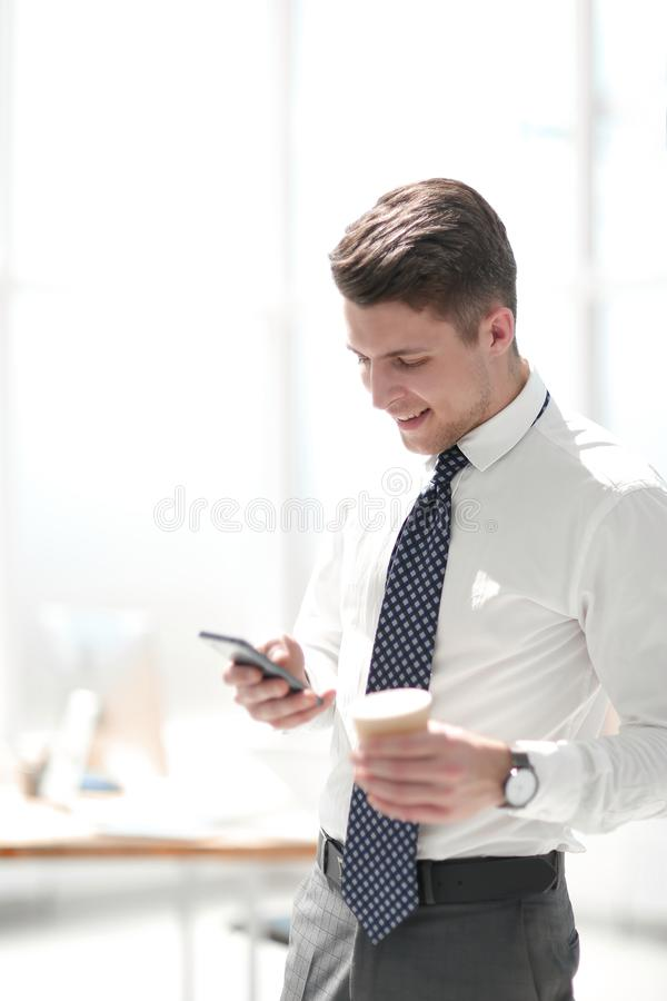 Young employee reading email during work break stock photos