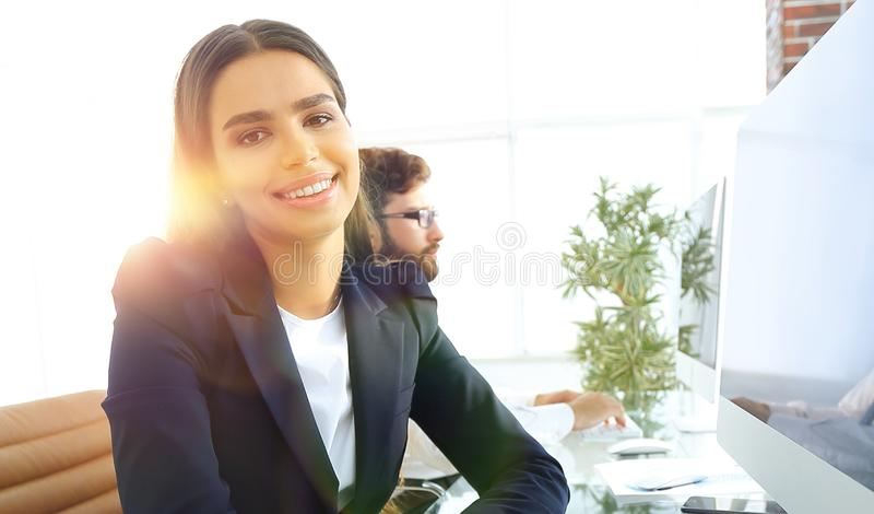 Young employee sitting at a Desk. Closeup of a young employee sitting at a Desk royalty free stock images